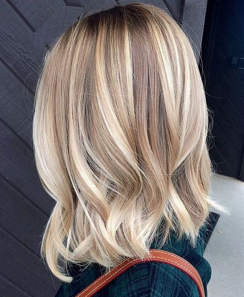 wavy bronde hair with lots of blonde balayage to look bold and cool