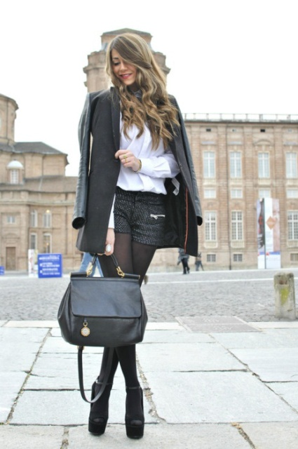 With white blouse, long jacket, black leather bag and platform shoes