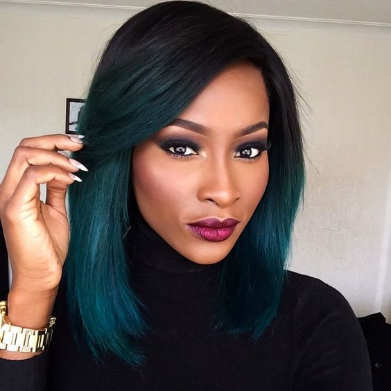a black roots with teal ombre for a very contrasting look
