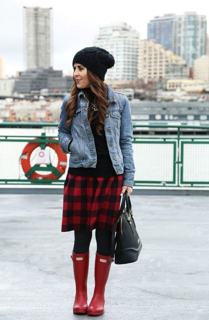 With black shirt, denim jacket, black beanie, black tights, red boots and black bag