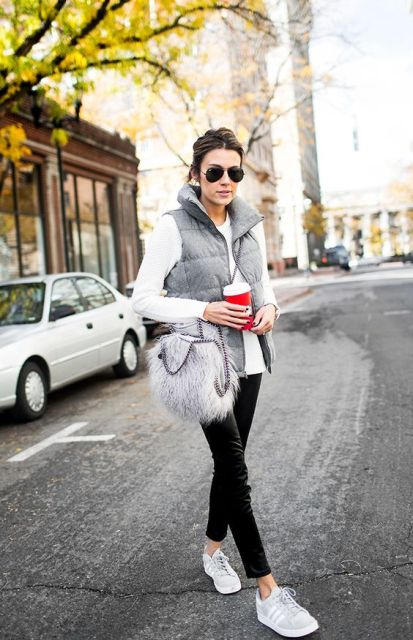 With white shirt, gray puffer vest, black pants and white sneakers
