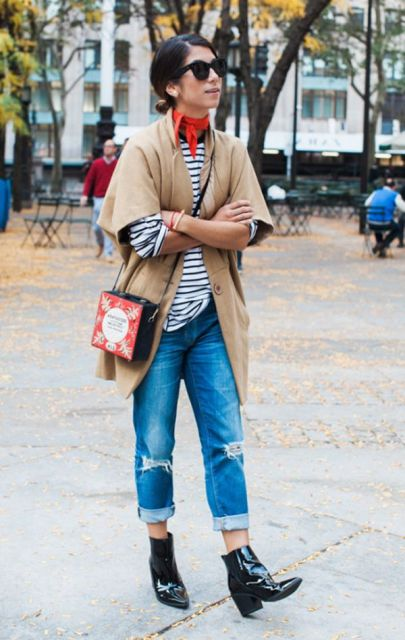 With striped shirt, camel cardigan, cuffed jeans, ankle boots and unique bag