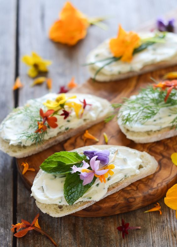 cream cheese and chive sandwiches with edible flowers for a romantic feel