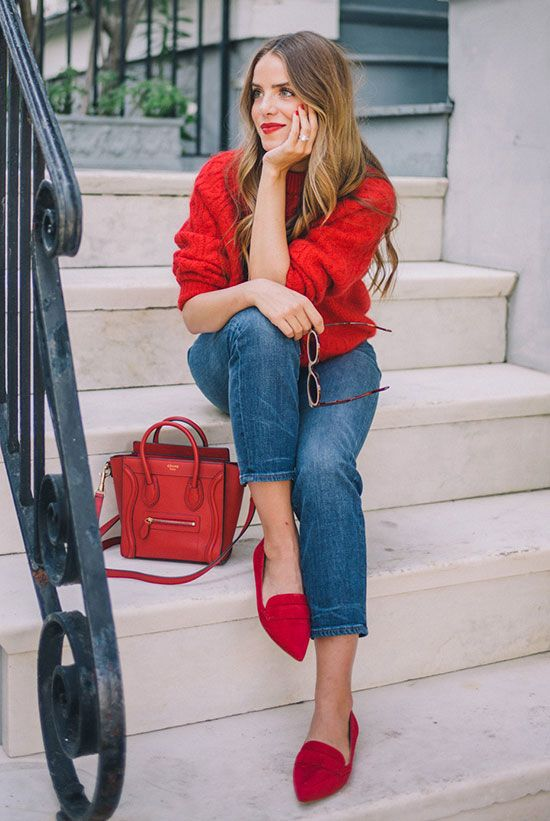 a red chunky knit sweater, cropped jeans, fuchsia flats and a red bag