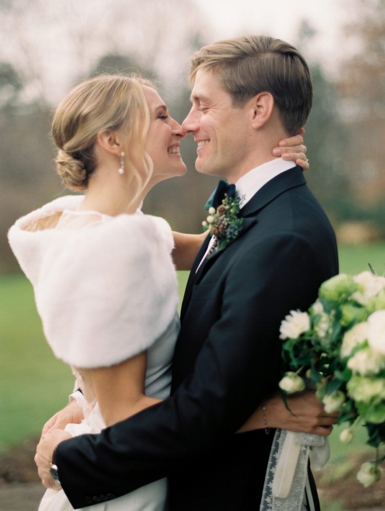 The bride covered up with a faux fur stole and added pearl earrings