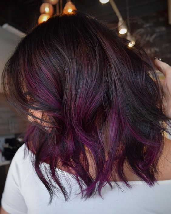 wavy brown long bob with balayage in various shades of purple for a modern feel
