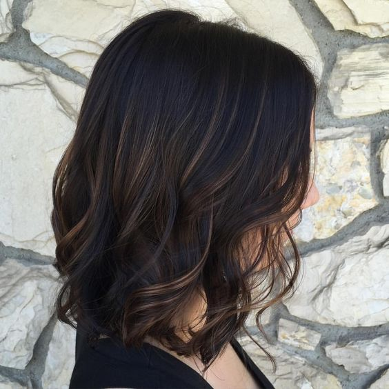 black wavy bob with subtle bronde balayage gets a dimension at once
