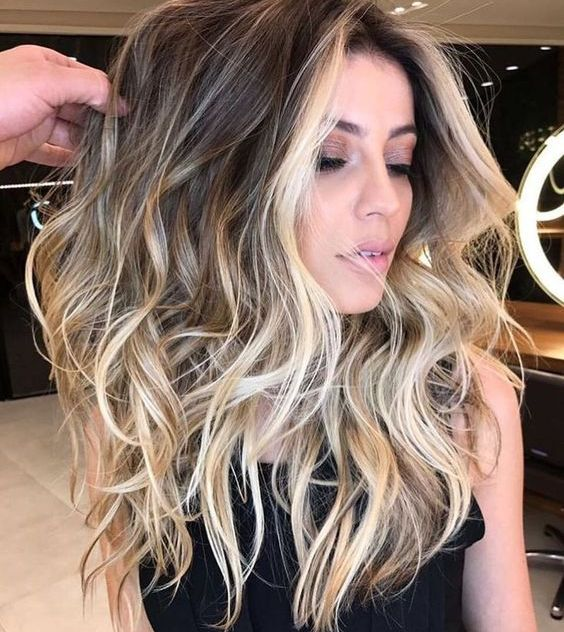 brown hair with blonde balayage plus face-framing to highlight the face