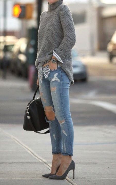 ripped blue jeans, a striped shirt, a grey turtleneck sweater and grey shoes