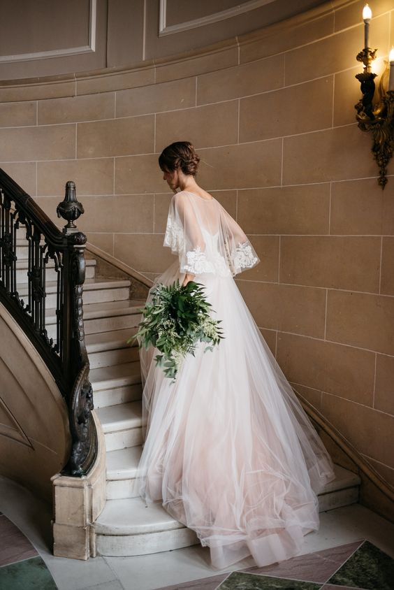chic Kelly Faetanini wedidng dress with spaghetti straps, an ombre blush skirt and a lace rim capelet