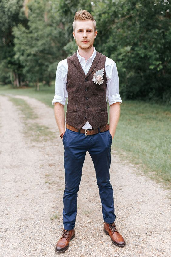 navy pants, a white shirt, a blush boutonniere and cognac-colored shoes, no tie for a relaxed look