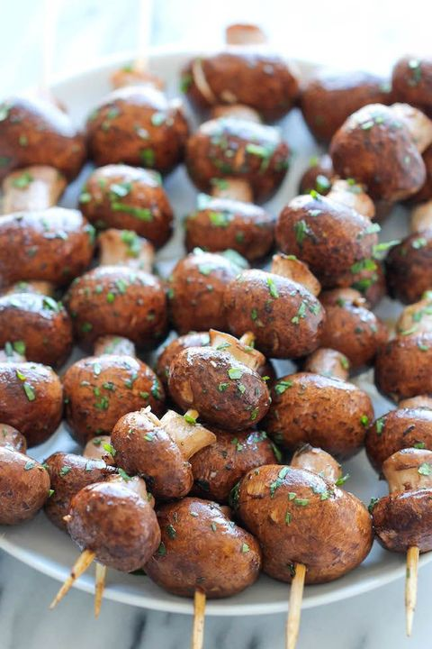 champignons on skewers with fresh herbs make a great appetizer for a woodland wedding