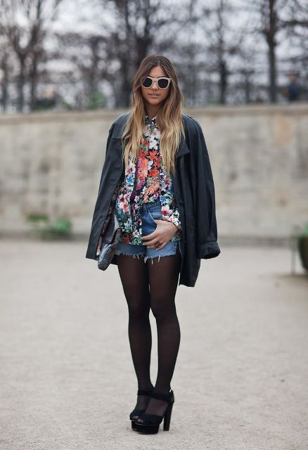 With floral blouse, navy blue coat and black heels