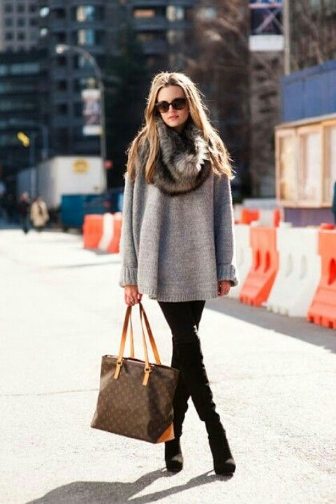 black suede boots, black skinnies, a grey oversized sweater, a faux fur scarf