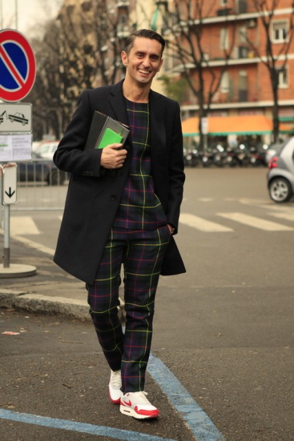 With plaid shirt, black coat and sneakers