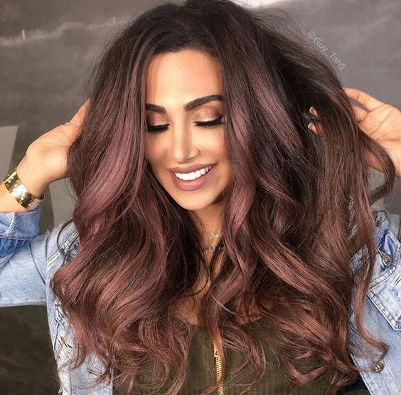 rose gold highlights on chocolate brown hair for a unique look