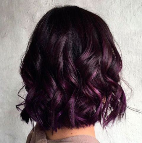 a short wavy bob of a deep chestnut shade and purple balayage for refreshign highlights