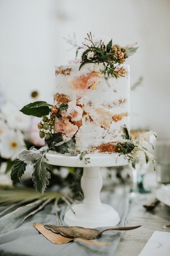 a naked cake with fresh herbs, berries and sugar geodes that are a cool wedding trend