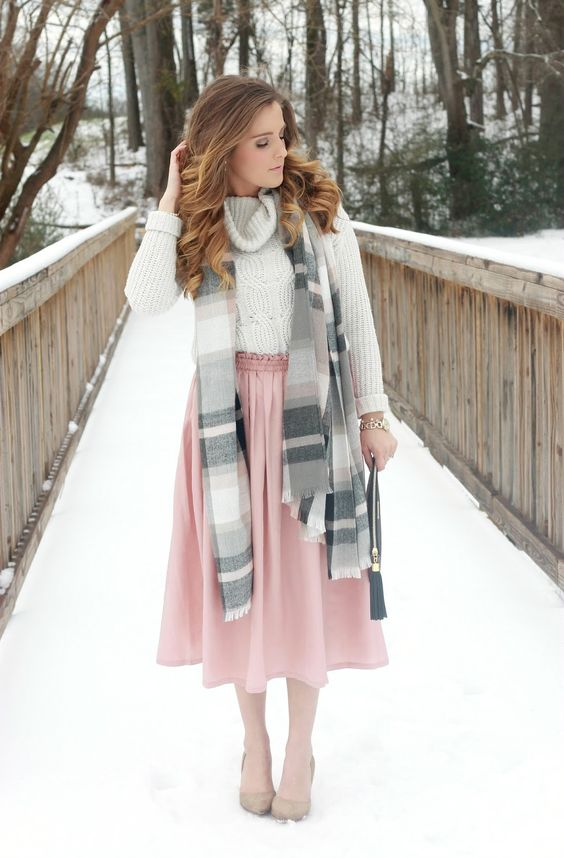 a neutral cable knit sweater, a pink skirt, nude heels and a striped scarf