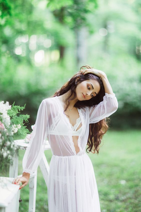 a sheer white long robe with long sleeves and a chic feminine bralette for a sexy look