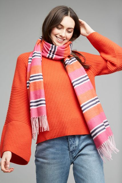 With orange oversized sweater and jeans