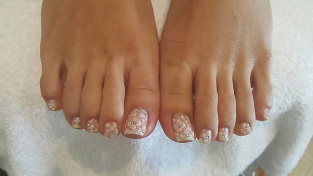 White Floral Nail Art Pedicure with Gems for a Wedding Pedicure Idea for brides