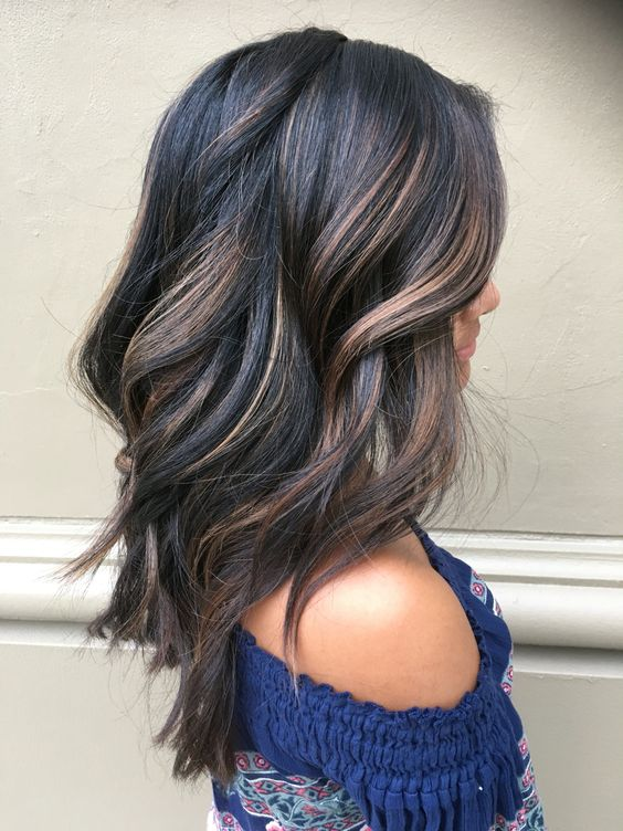 give your black hair dimension with brown and caramel balayage