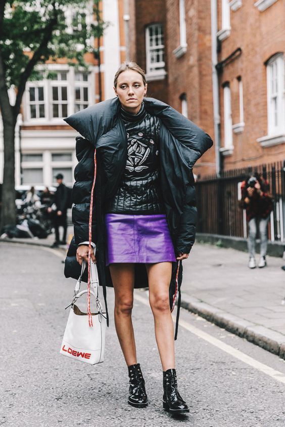 a ultraviolet leather mini skirt, an oversized puffed coat, lacked boots for a trendy winter outfit