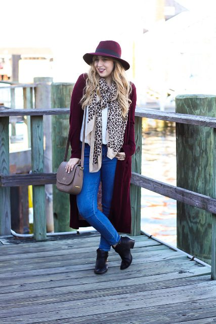 With marsala long cardigan, marsala wide brim hat, jeans, black boots and bag