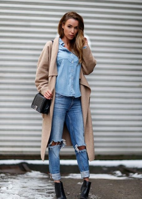 With denim shirt, distressed jeans, black ankle boots and mini bag