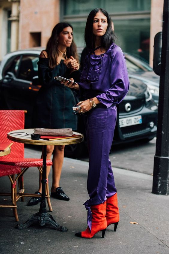 a silk ultraviolet jumpsuit and orange velvet boots for a super bold look