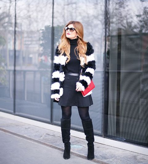 With turtleneck, mini skirt, high boots and red bag
