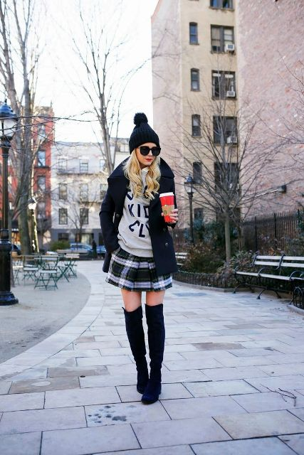 With sweatshirt, over the knee boots, beanie and jacket
