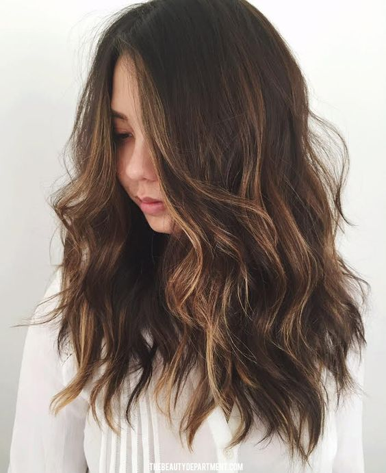 long dark wavy hair with subtle bronded and caramle highlights