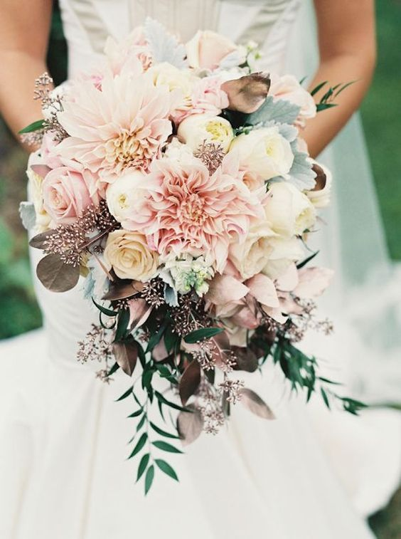 pastel pink wedding bouquet with dahlias, roses and dark leaves to make a contrast