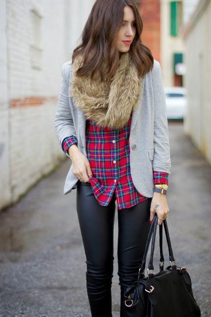 With plaid shirt, gray jacket, leather pants and black bag