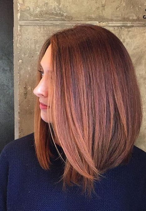 bold red hair with rose gold highlights on medium length hair