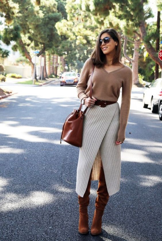 a tan cashmere top, a creamy asymmetric skirt, tall boots and a matching bag