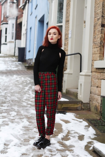 With black turtleneck and flat shoes