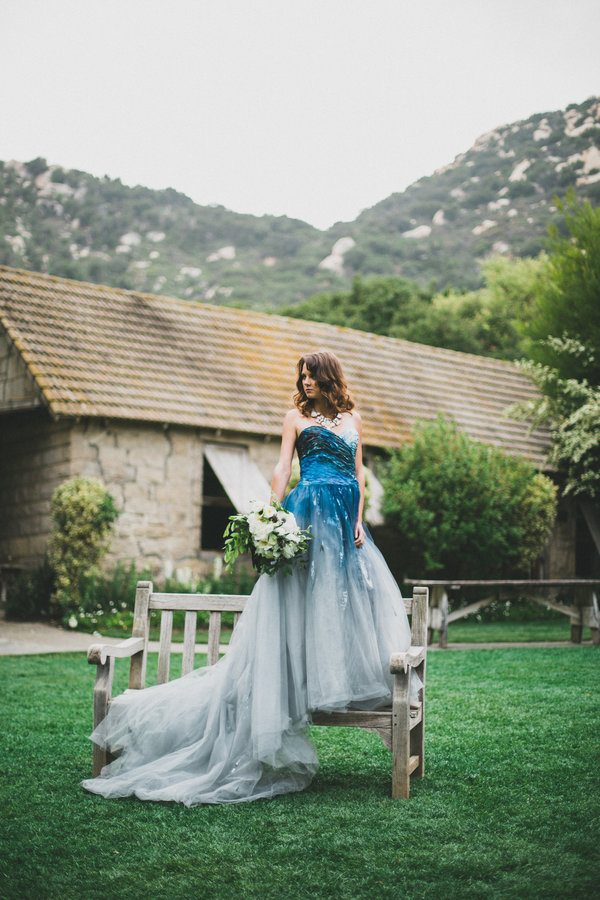 a strapless bold blue to light slate grey wedding dress with a train