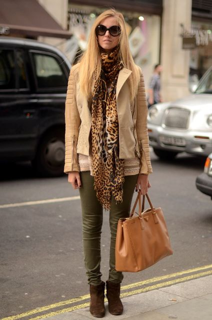 With beige sweatshirt, beige leather jacket, olive green pants, brown suede boots and brown tote