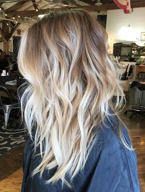 light wavy layered bronde hair with blonde balayage for a highlight