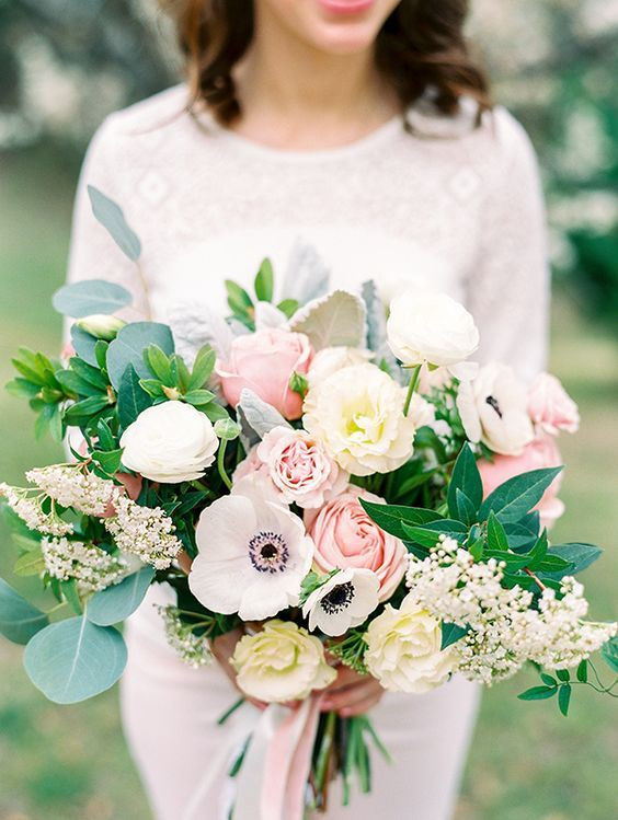 textural wedding bouquet with pink and white roses, white anemones, greenery and some little blooms