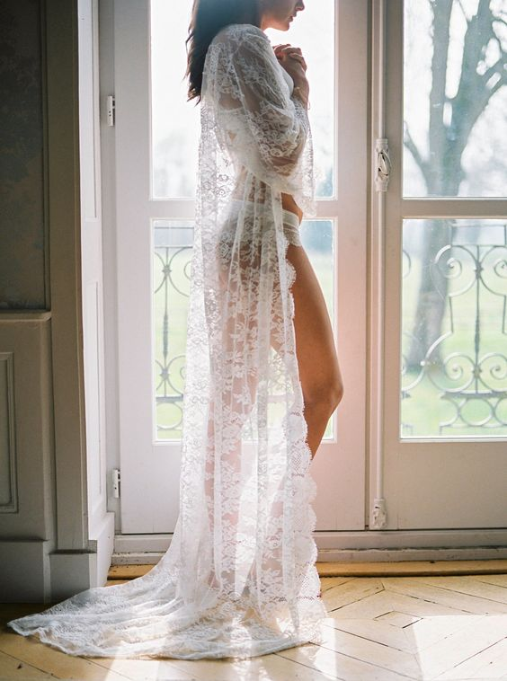 a long lace robe of Chantilly lace with long sleeves and a small train over your wedding day lingerie