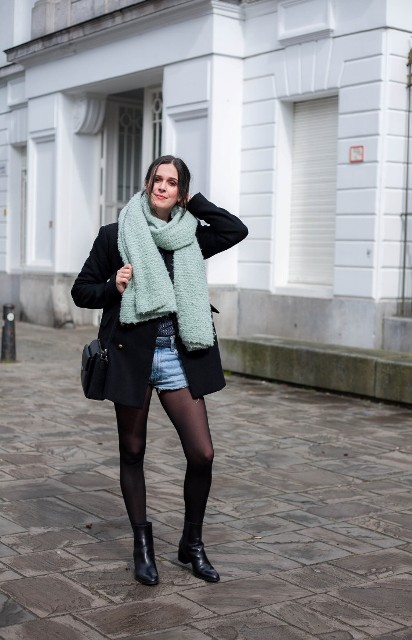 With black mini coat, ankle boots, mint green scarf and black bag