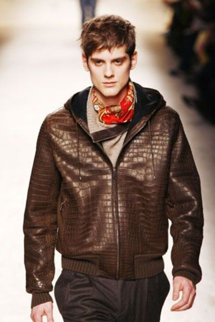 With sweater, gray trousers and brown leather jacket