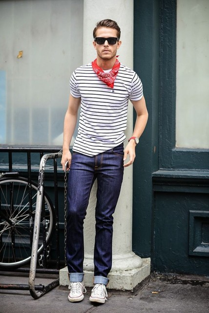 With striped shirt, cuffed jeans and sneakers