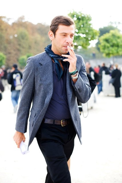 With navy blue shirt, gray tweed blazer and black pants
