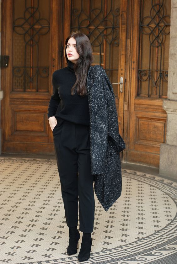 black cropped pants, a black turtleneck, black suede booties and a coat