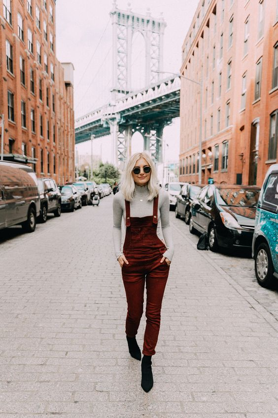 black suede sock boots, a grey turtleneck and a burgundy velvet overall for a stylish look